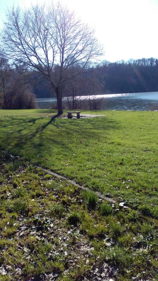 seating area by river winters day in feb